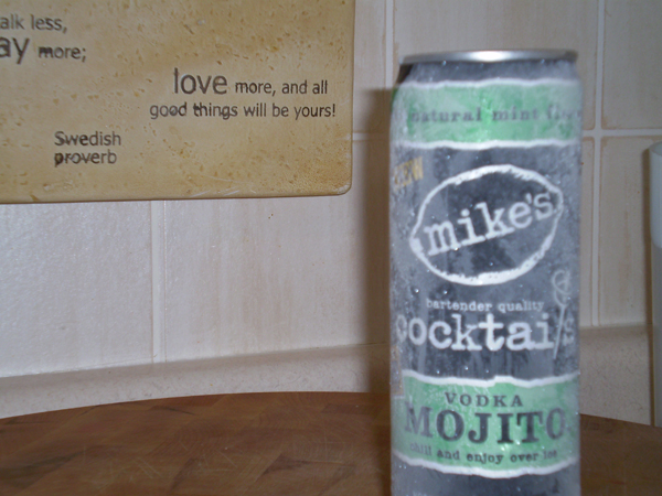 An ice cold vodka mojito with frost on the can and sweedish proverbs in the background.